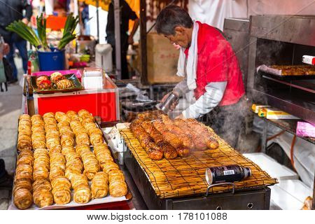 KYOTO, JAPAN - NOVEMBER 10, 2016: Japanese street food in Kyoto, Japan. Japanese street food, called yatai by the natives, is based on mobile food stands where people can get delicious specialties.