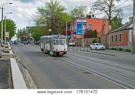 Dnipro Ukraine - April 19 2016: Tramway traffic on the city street in middle of spring early in the evening