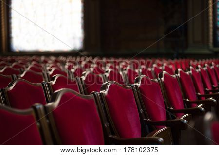 Empty theater hall - - Red armchairs