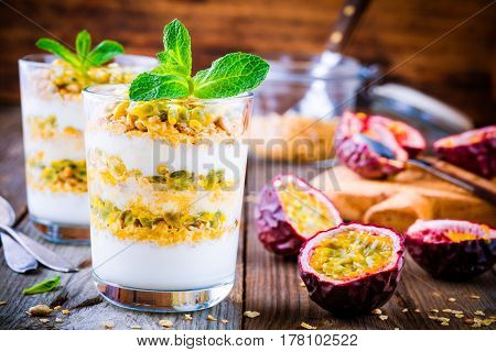 Yogurt Parfait With Granola, Peach Sauce And Passion Fruit With Mint