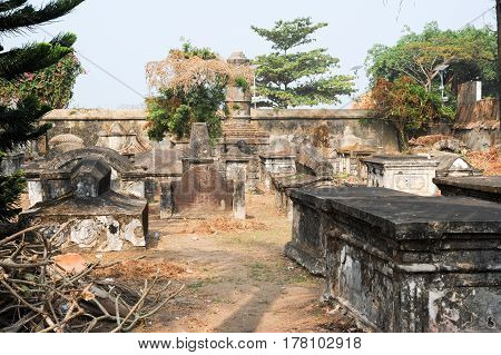 Fort Cochin, India - 16 January 2015: The old Dutch cemetery of Fort Cochin on India