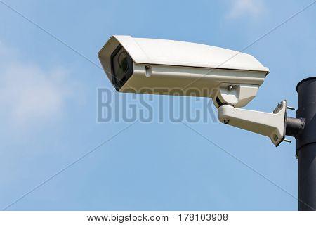 Single CCTV Security camera on clear sky background