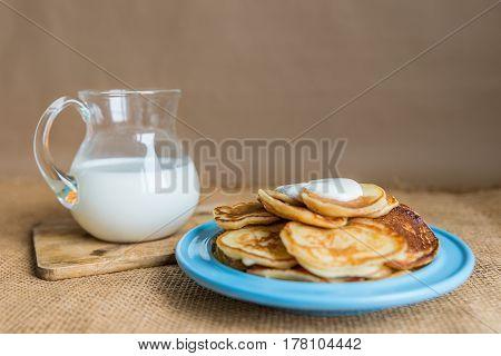 pancakes with jam, sour cream and milk