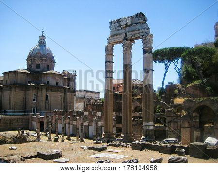 Roman Forum - historical plaza with ruins of ancient government buildings in Rome city center in Italy. Popular european travel landmark on summer day