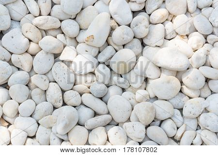 White pebble on the small zen garden ground. Decoration material for garden