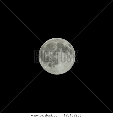 The silver full moon isolated on black.