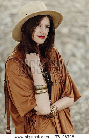 Beautiful Stylish Hipster  Boho Woman With Hat, Leather Bag, Fringe Poncho And Boots. Girl In Gypsy