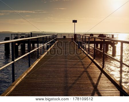 Long Wooden Pier At Coast, Cold Morning, Peaceful Silent Day