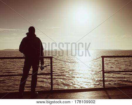 Alone Artist On Wooden Sea Bridge.  Man On Wooden Sea Mole