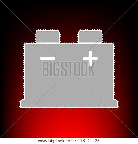 Car battery sign. Postage stamp or old photo style on red-black gradient background.