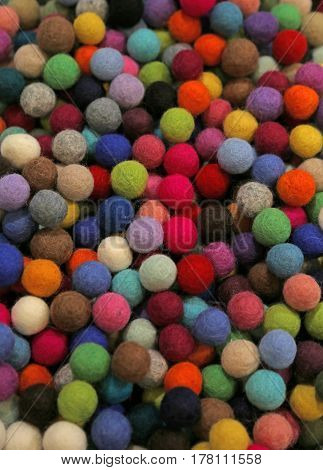 background Close-up of multicolored felt little balls