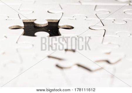 close up of a jigsaw over a black background. problem solving. business. solution.