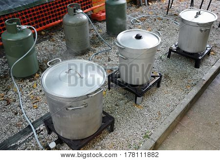 Large Pots And Gas Cylinders In The Kitchen For Food Preparation