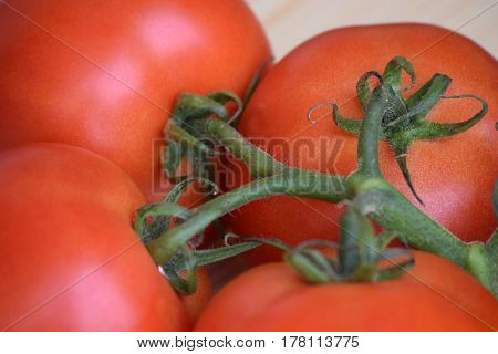 Few red tomatoes in a bunch, taken close-up