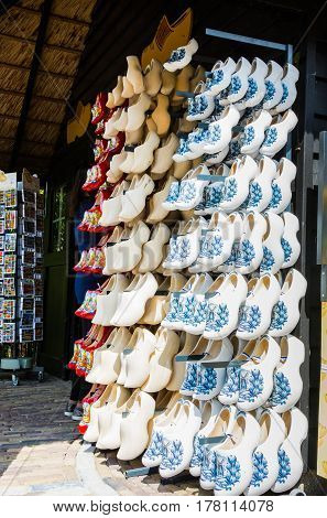 KEUKENHOF THE NETHERLANDS - MAY 10 2014: Traditional Dutch wooden shoes sold in a souvenir shop in Keukenhof The Netherlands. Clogs are part of Dutch culture