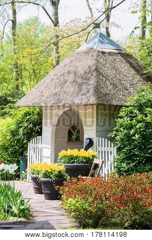 Small cosy alcove surrounded by blooming flowers in Keukenhof park in Netherlands Europe