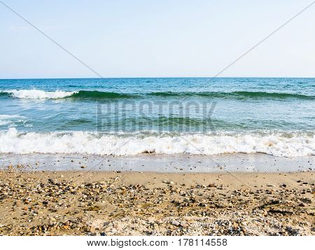 Sea Tidal Waves With White Foam On A Sunny Sandy Beach In Resort On Summer Vacation. Background Of O