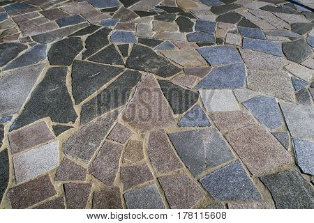 ASSENS DENMARK - MARCH 24 2017: Closeup tiling at the end of the modern designed walkway on pier a springtime day close to the sea. March 24 2017 Assens Funen Denmark.