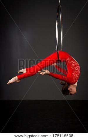 Woman Exercising On Lyra