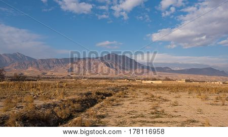 Beautiful landscape shot with beautiful sky and mountains background in Kashan, Iran