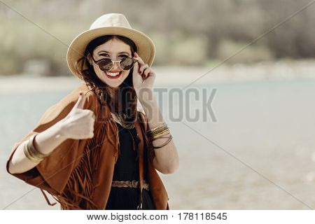 Stylish Traveler Hipster Woman Smiling Showing Thumb Up, In Sunglasses With Hat, Leather Bag, Fringe