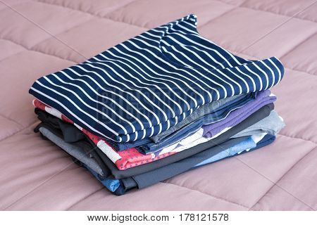 Folding Clothes On The Bed Before Keeping In Wardrobe