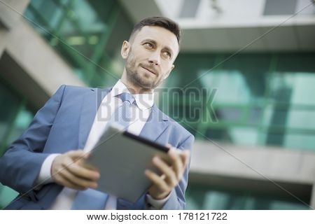 middle aged man working with tablet outdoor