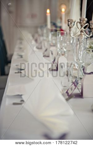 A very nicely decorated wedding table with plates, serviettes and signs. Scandinavian style. Sample and clean