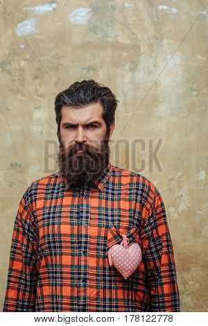 Bearded Man With Beard With Rosy Textile Heart On Shirt