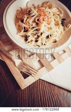 delicious italian pasta with spinach for vegetarians; on white plate