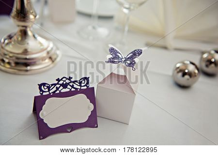 Romantic vintage name sign on the table at wedding reception closeup. Free space for writining