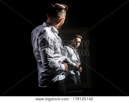 Muscular Macho Man In White Shirt Near Vintage Mirror