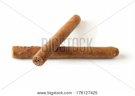 two cuban cigars closeup lying one on other on white background