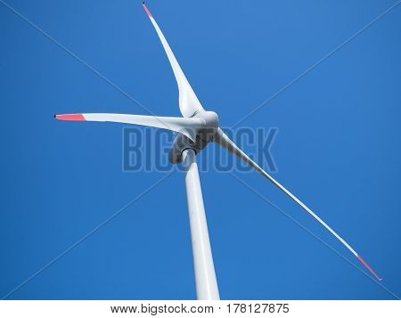 wind power plant and blue sky without clouds