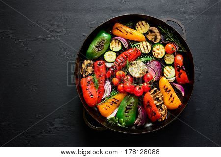 Grilled vegetables in a cast iron grilling pan view from above space fora text