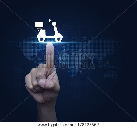 Hand pressing motor bike icon over digital world map technology style Business delivery service concept Elements of this image furnished by NASA