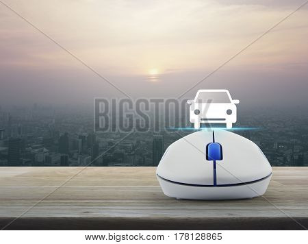 Car flat icon with wireless computer mouse over modern city tower at sunset vintage style Internet transportation service concept