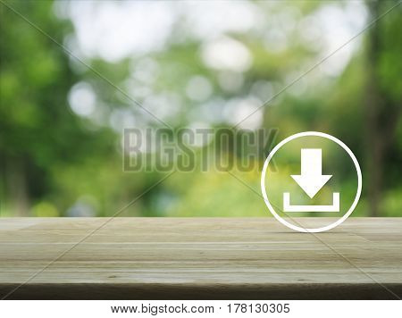 Download icon on wooden table over blur green tree in park Business internet concept