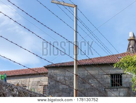 barbed wire in front of the prison building