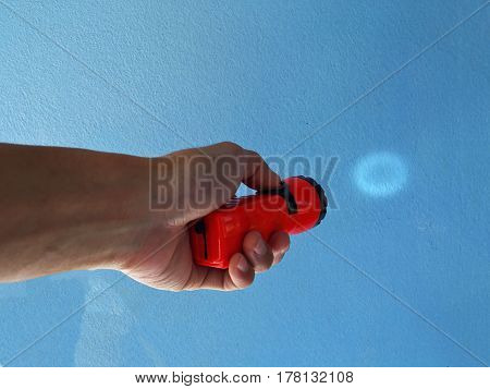 hand hold torch on a white background.