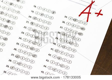 Final Exam Marked With A+ With Red Pencil