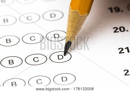 Test Score Sheet With Answers And Pencil . Closeup.