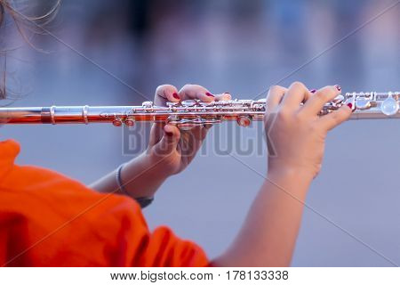 The hand positioning of a flute player