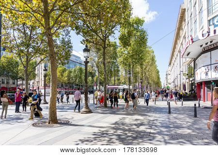 PARIS, FRANCE - August 28, 2016 : Tourists on foot Graben Street view around Paris city. Paris is the capital and most populous city of France. Paris, France
