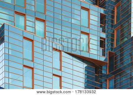 Anapa Krasnodar region Russia - March 03.2017: Original kinks blue-orange glass facade of a luxury residential complex
