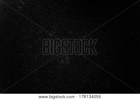Dark vintage background with scratches. Place for text. Can be used to effect dust and abrasions.