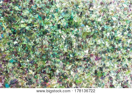 Particle of shattered green glass texture background
