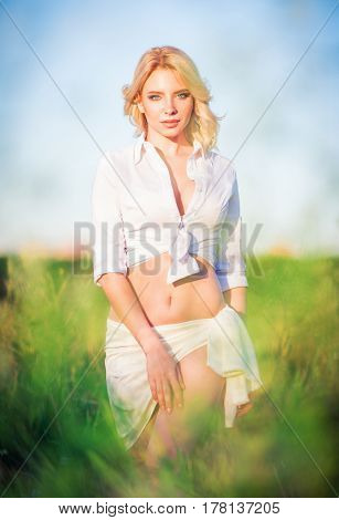 Beautiful young girl standing in the field
