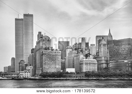 New York City skyline from NJ with World Trade Center featured as landmark of Twin Towers. Lower Manhattan in NYC, United States. Black and white background.