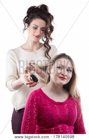 Hairdresser and smiling client on white background